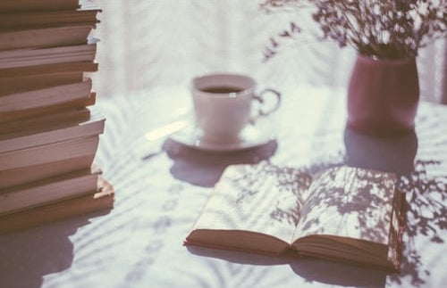 aesthetic books with coffee and flowers