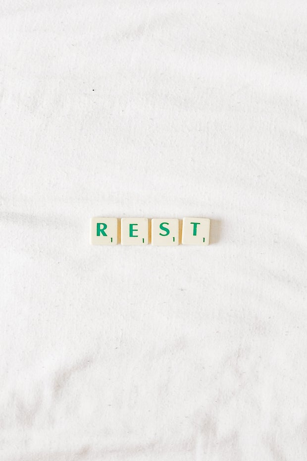 Tiles spelling out the word 'rest'
