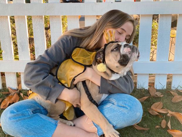 Photo of Madison Hoffman and her dog Lulu