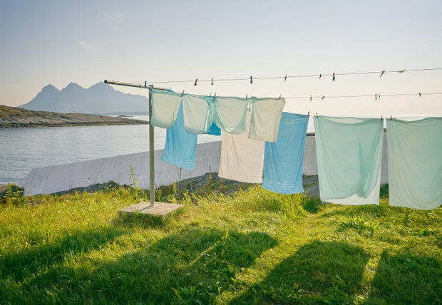 towels hanging on outdoor clothes line