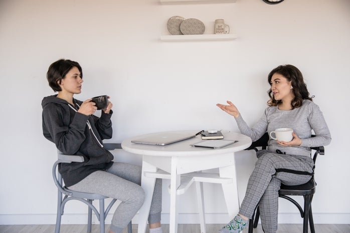 Photo of women talking to each other