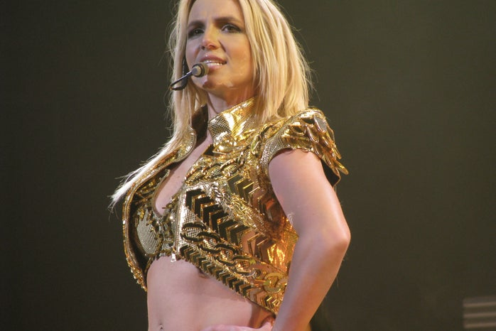britney spears performing in a gold top