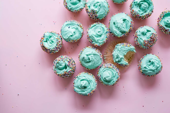 dozen cupcakes with teal icing