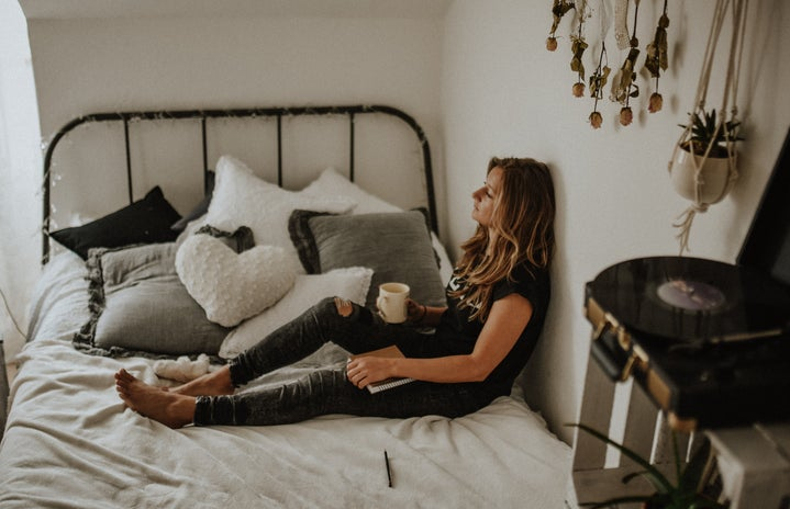 Women siting on her bed