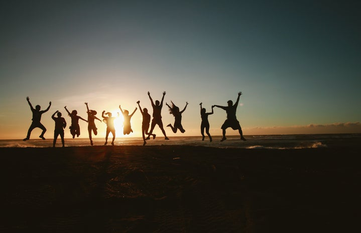 People jumping into the sunset.