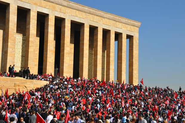 A crowd of people with Turkish flags flooding the Turkish parliament