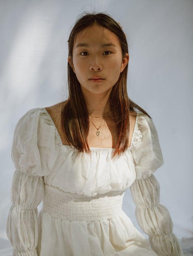 Girl in white puffy-sleeved dress