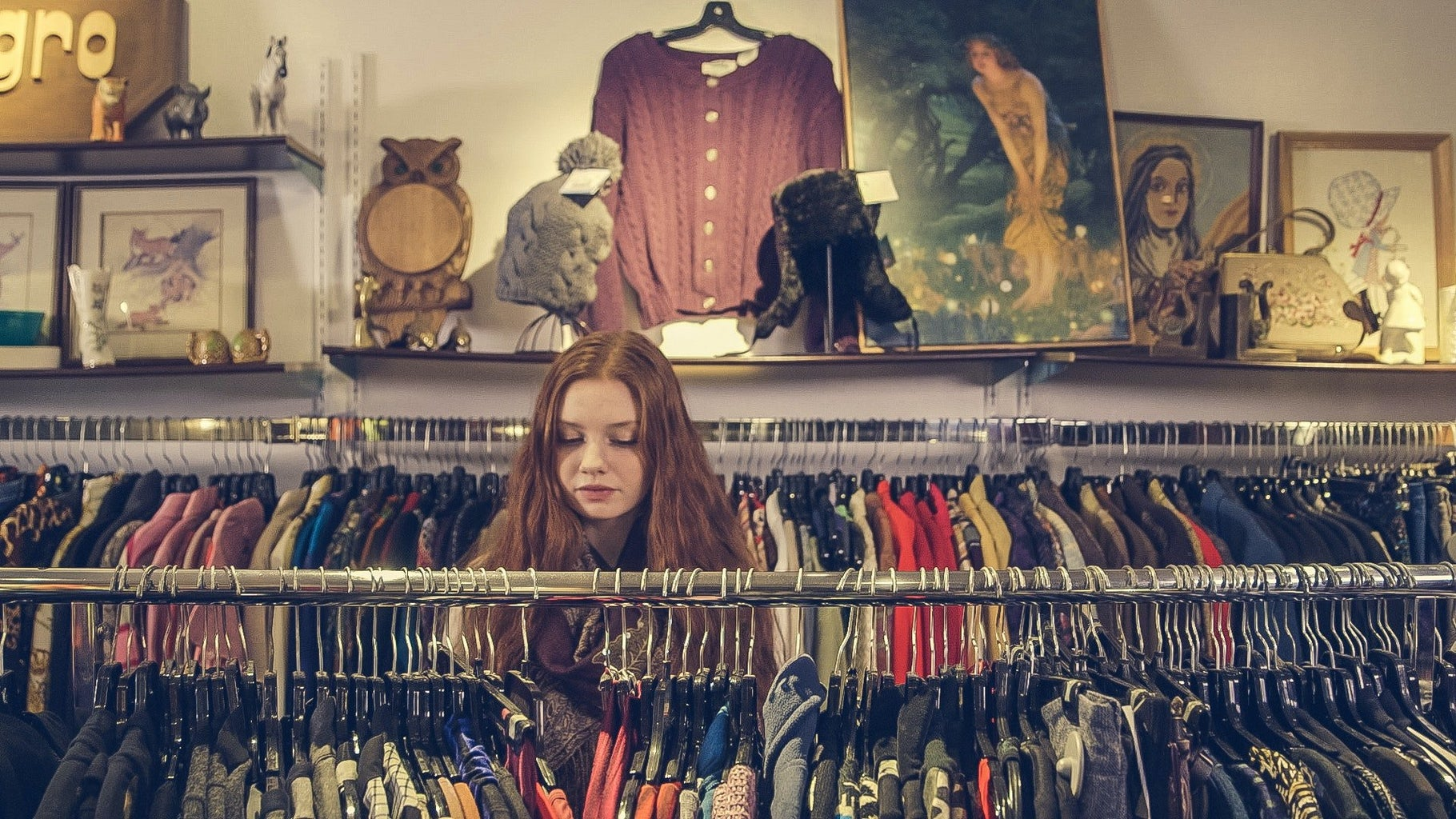 woman shopping for clothes in store