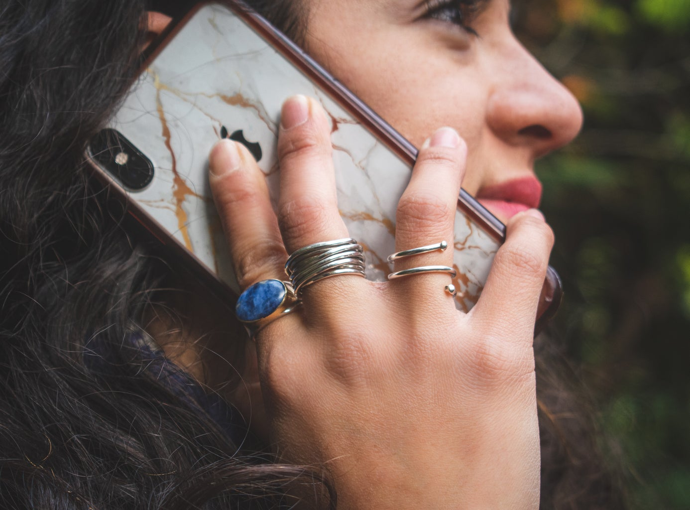 Woman holding an iPhone to her ear