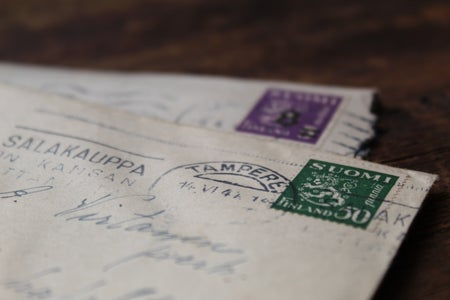 close up of old letters with printed writing and stamps