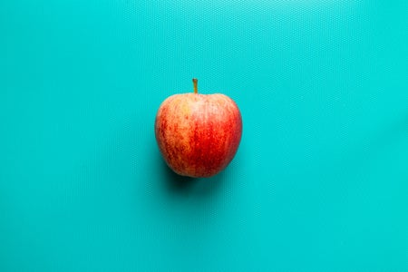 apple on blue surface