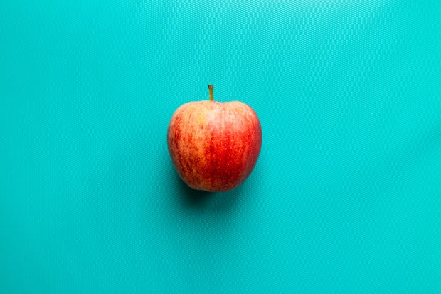 apple on blue surface
