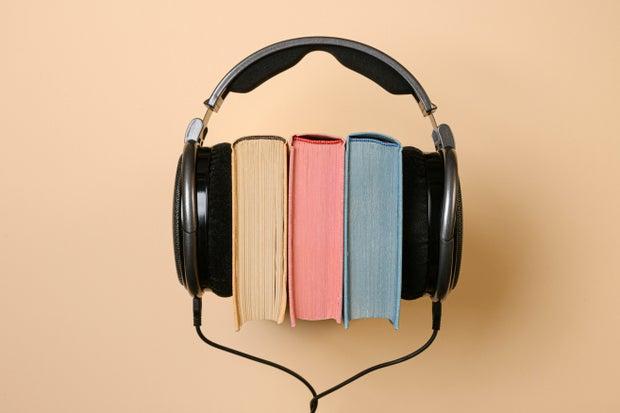 black headphones and book