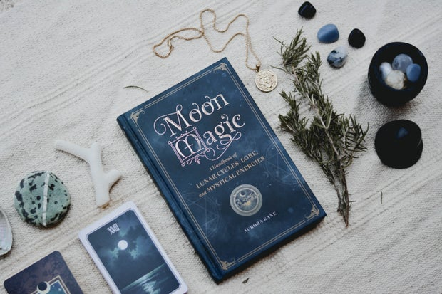 Moon magic book on a wicca altar