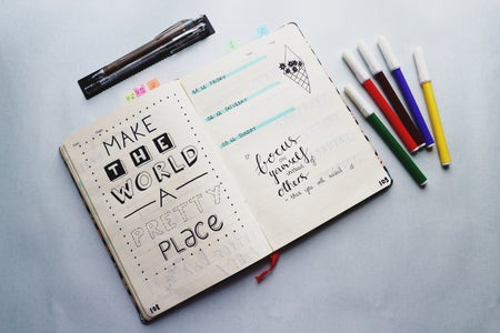Journal along with colourful pens