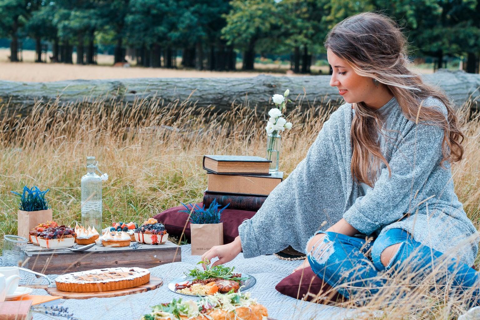woman sitting on blanket having a picnic