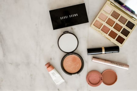 Makeup products on a white surface