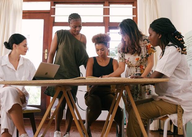 Women gather around a table