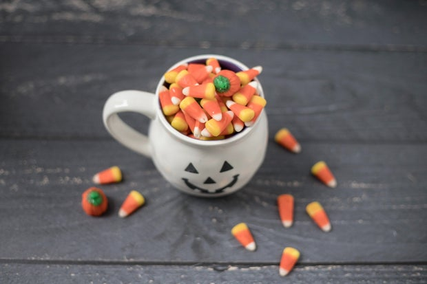 Halloween jack-o-lantern mug filled with candy corn