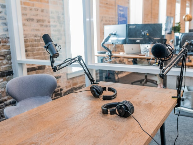 podcast setup on a wooden table