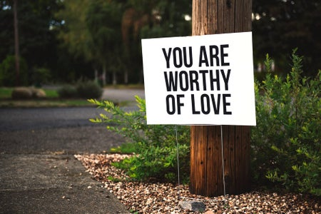 "Sign that reads ""you are worthy of love"""