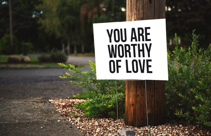 """Sign that reads """"you are worthy of love"""""""