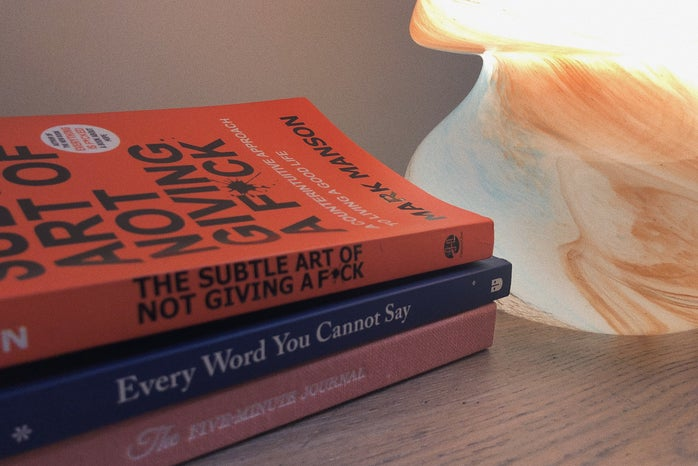 stack of books and a lamp