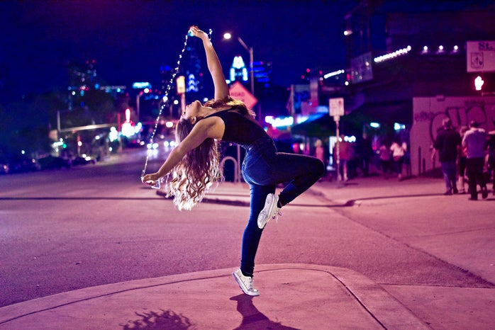 girl dancing with fairy lights