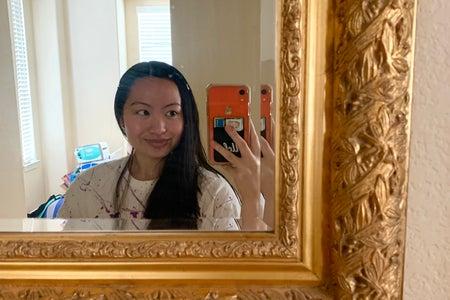 cute girl taking mirror selfie