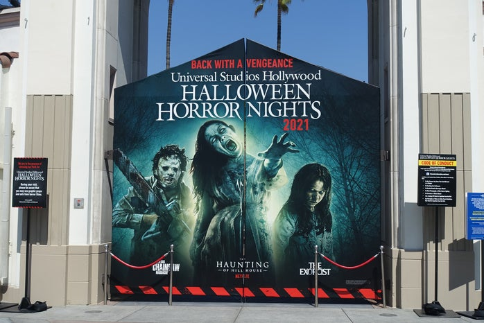 In the image you can see Universal Studios Hollywood\'s top mazes of the year. The haunting of the hill house, the exorcist, and Texas chainsaw. This is the banner outside of their gates in the front of the park.