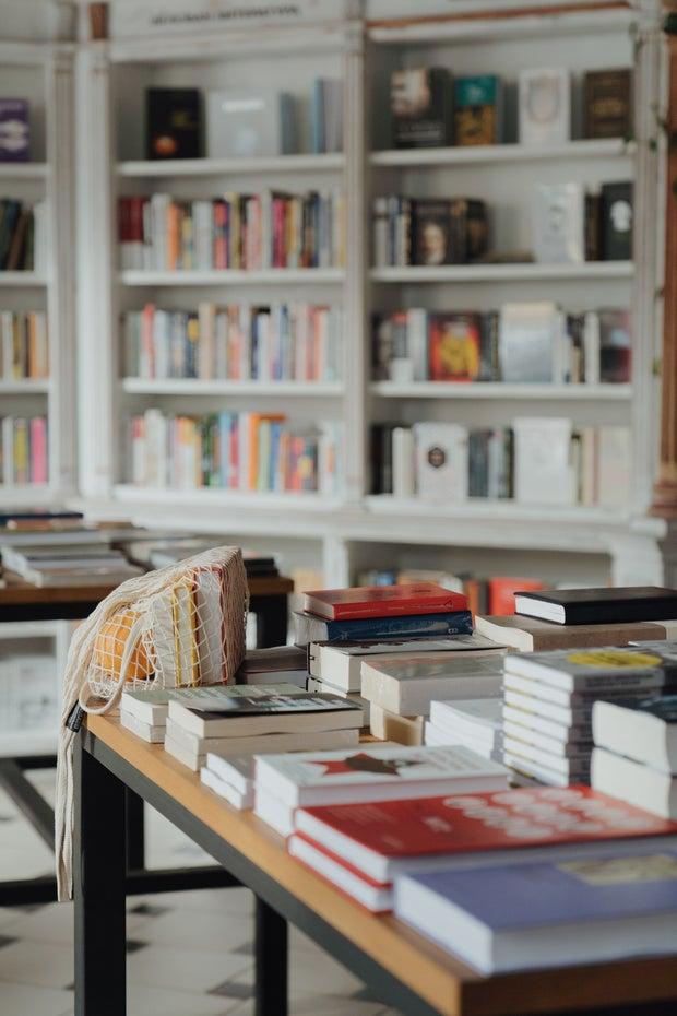 books on white modern shelf