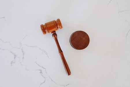 Gavel on white marble