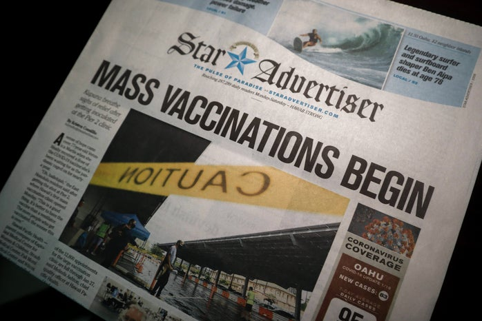 Newspaper with Vaccine distribution title