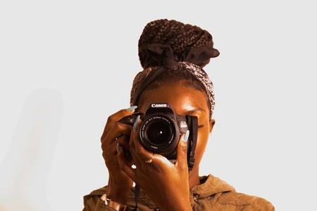 woman using a camera