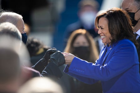 Kamala Harris and Joe Biden bump fists during the 2021 presidential inauguration