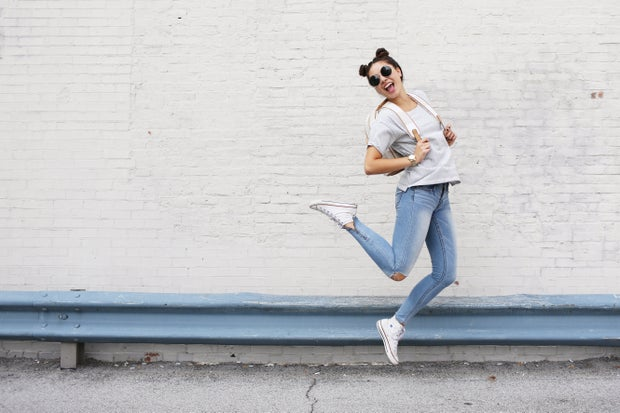 girl sunglasses jumping backback converse happy