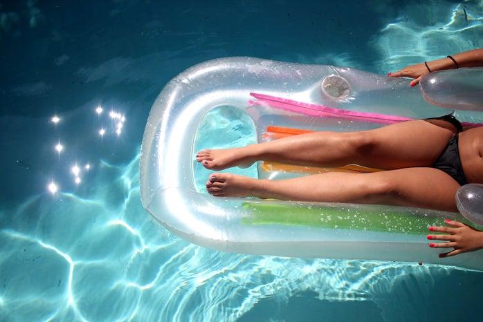 summer girl legs swimming pool