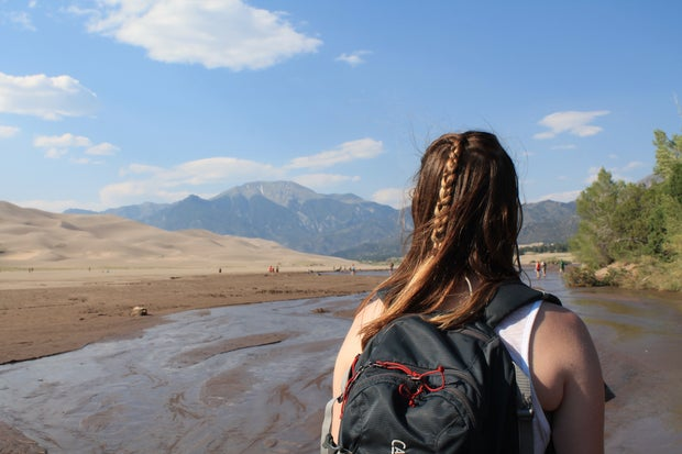 girl mountains sand summer adventure roadtrip braid backpack creek