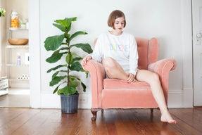 girl thinking college sweatshirt