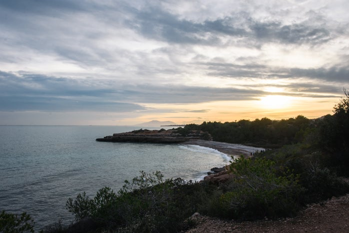 beach spain europe abroad sunset mountain nature trees water mediterranean sea
