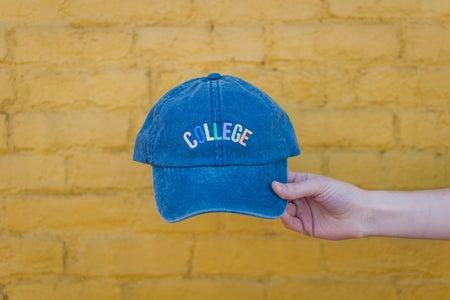 blue college cap yellow wall far