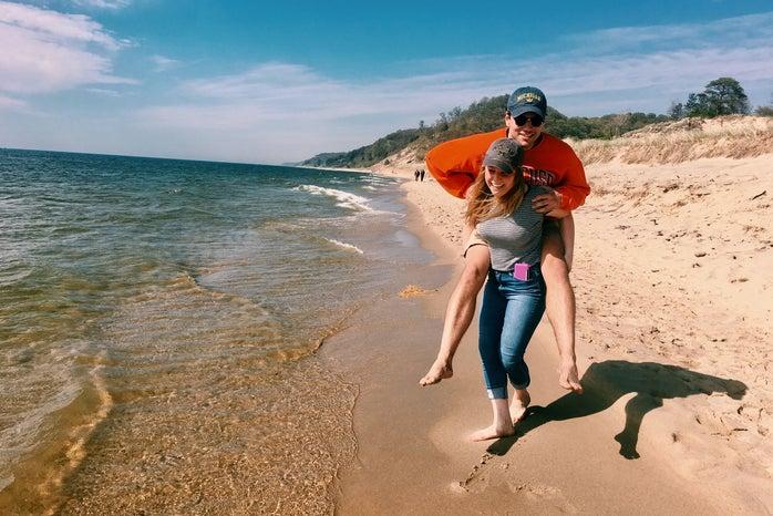 girl boy beach fun sand summer jeans
