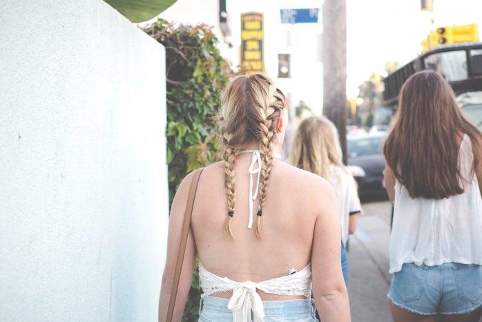 girl french braids walking friends adventure california open back venice beach