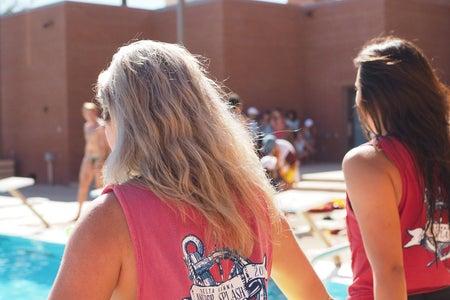 friends sorotiy philanthropy floaty arizona jumping in pool social