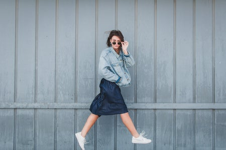girl with jean jacket and skirt jumping 1