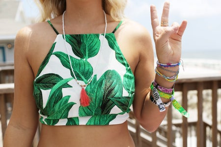 peace sign crop top beach bracelets necklace blonde hair torso tropical