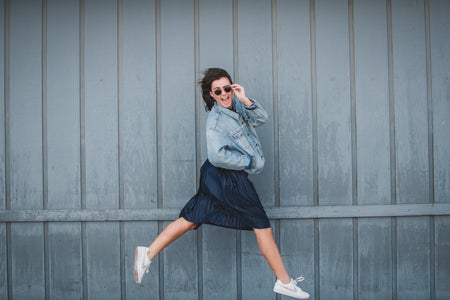 girl with jean jacket and skirt jumping 2