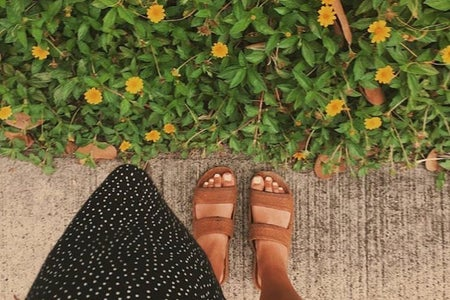 sandals sidewalk flowers