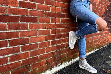 Meredith Kress-Brick Wall Ripped Jeans Leg Up