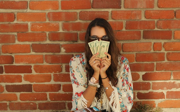 Kellyn Simpkin-Girl Holding Money
